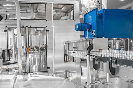 Empty plastic bottles on conveyor belt. equipment at the dairy plant