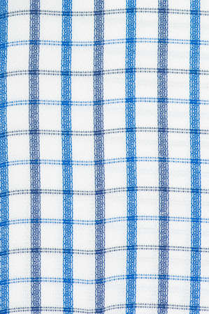 Background of the texture of the fabric. Cell pattern