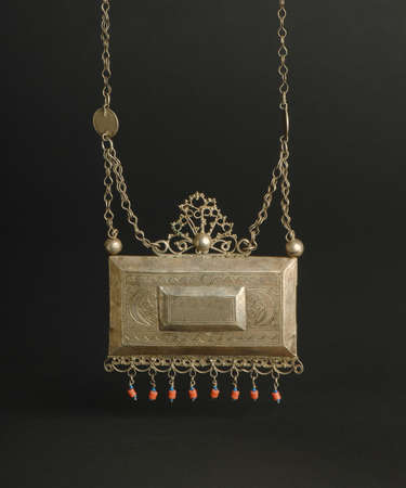 ancient antique pendant with stones on black background. Middle-Asian vintage jewelry Archivio Fotografico