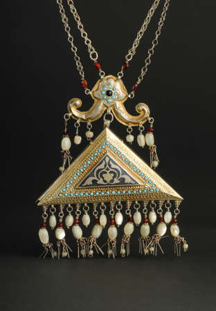 ancient antique pendant with stones on black background. Middle-Asian vintage jewelry Imagens