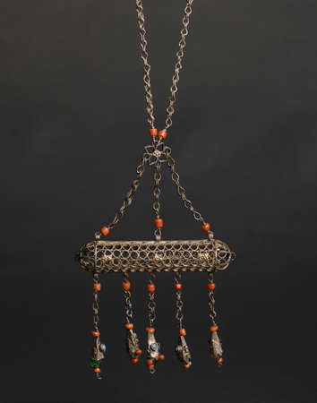 ancient antique pendant with stones on black background. Middle-Asian vintage jewelry Stok Fotoğraf