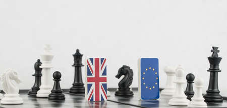 Chess pieces and flags of the European Union and the Britain on a chessboard. The concept of the political game and chess strategy Brexit