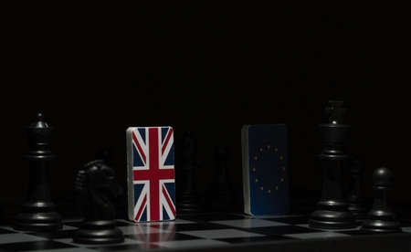 Backlit in the shadows figures and flags of the European Union and Great Britain on the chessboard. The concept of the political game and chess strategy Brexit 免版税图像 - 121990029