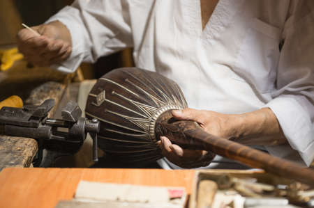 adult master restores old musical instruments. production of stringed instruments