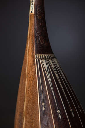 part ancient Asian stringed musical instrument on black background with backlight