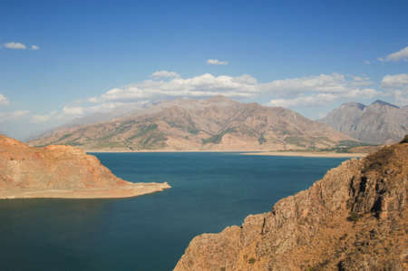 landscape with lake and mountain views. Uzbekistan, Charvak reservoir. Nature of Central Asia