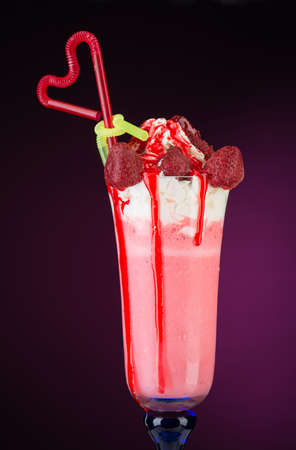fruit cocktail ice cream with straw on red background, isolated. summer tropical smoothie 写真素材