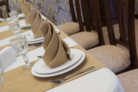 serving banquet table in a luxurious restaurant in beige and white style