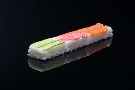 sushi on black background with reflection