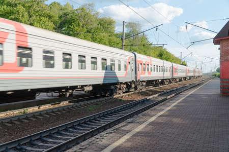 passenger train on the railway against the sky