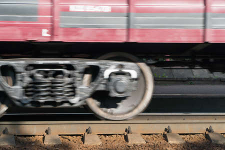 close - up of the train wheel in motion on the railway