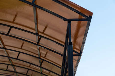 plastic carport. brown transparent roof made of polycarbonate with metal structures