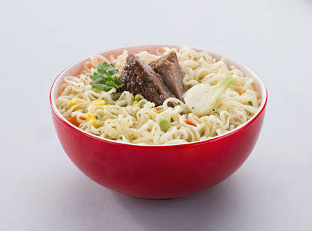 instant noodles with meat in a red bowl, insulated. fast food Reklamní fotografie