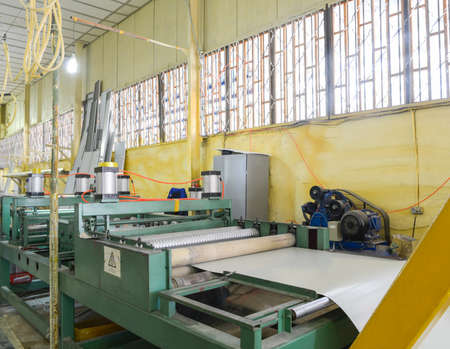Roller press machine. Plant for the production of sandwich panels from styrofoam Stock Photo