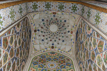 The ceiling in the form of a dome in a traditional ancient Asian mosaic. The details of the architecture of medieval Central Asia Editorial