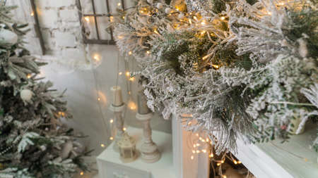 composition of Christmas decorations with fir tree and garlands. the sparkling lights