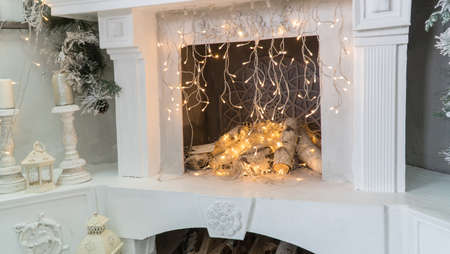 Christmas fireplace with glowing garlands 写真素材