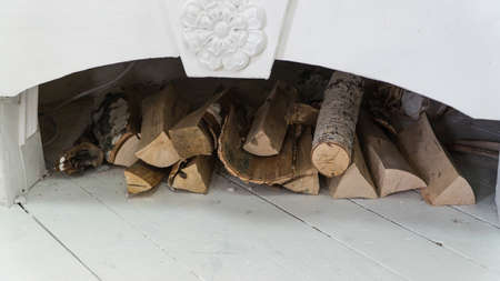 white decorated fireplace with firewood 写真素材