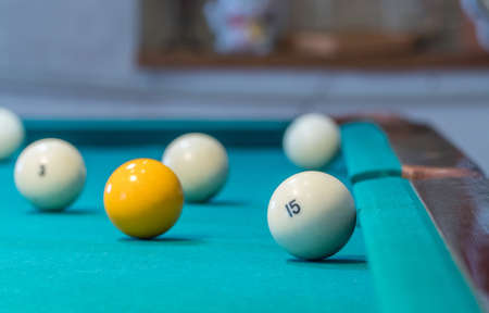Green billiard table with white balls