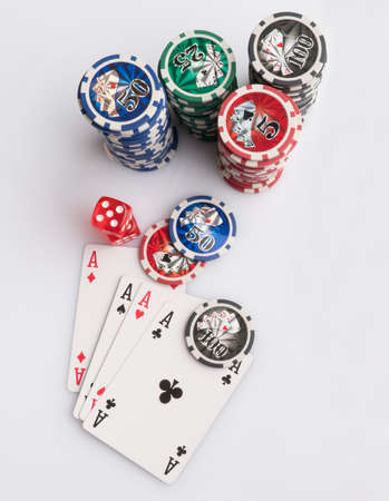 Poker chips, cards and dice on a white background. The concept of gambling and entertainment. Casino and poker Foto de archivo - 138268511