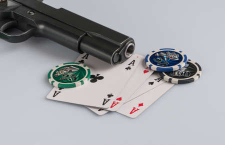 Poker chips, cards and gun on a white background. The concept of gambling and entertainment. Casino and poker