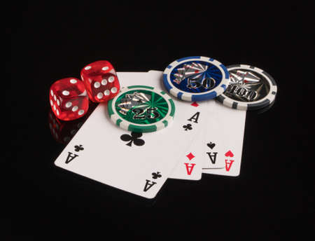 Poker chips, cards and dice on a black background. The concept of gambling and entertainment. Casino and poker Foto de archivo - 138288277