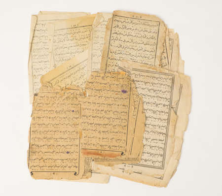 ancient old sheets of paper from the Arabic book, the Koran