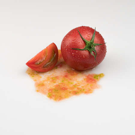 fresh wet tomatoes on a white background. sliced tomatoes with pulp Фото со стока
