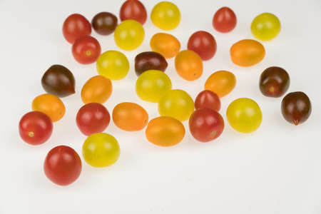 fresh multi-colored cherry tomatoes on a white background