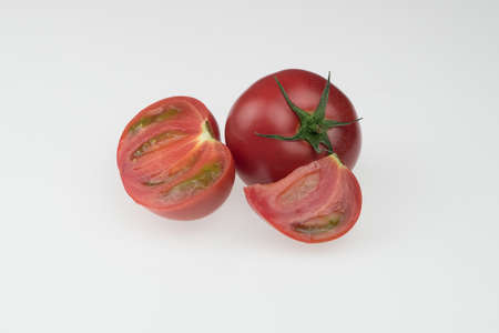 fresh tomatoes on a white background. sliced tomatoes