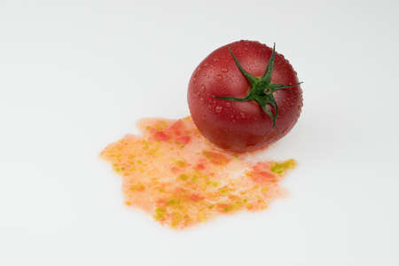 fresh wet tomatoes with pulp on a white background Фото со стока