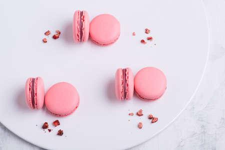pink Macaroni cookie French on white plate. Studio photo