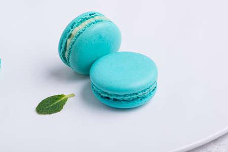 blue Macaroni cookie French on white plate. Studio photo