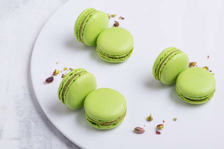 green Macaroni cookie French on white plate. Studio photo