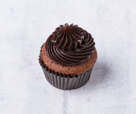 chocolate cupcake on white background, isolated Stockfoto