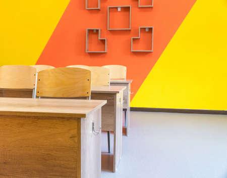 Empty school classroom with chairs, desks. Interior of a school classroom