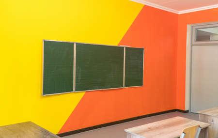 An empty school classroom with a blackboard. Interior of a school classroom