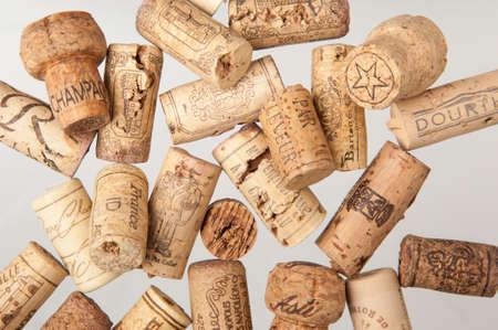 Tashkent, Uzbekistan - March 19, 2008: Heap of old wine corks on white background. Studio photography