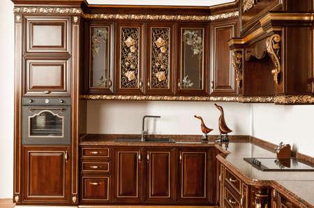 Tashkent, Uzbekistan - May 16, 2016: Luxury kitchen furniture in vintage style 免版税图像