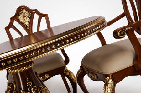 Luxury gold plated kitchen table and chairs in baroque style