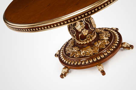 Luxury gold plated part kitchen table in baroque style. Close-up