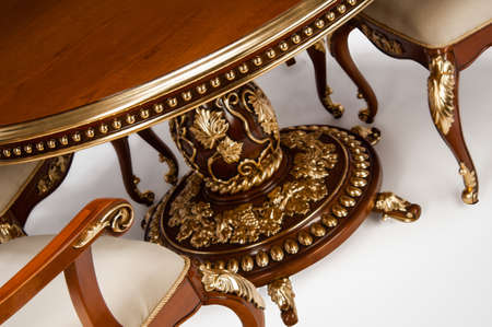Luxury gold plated kitchen table and chairs in baroque style Stok Fotoğraf - 158349375