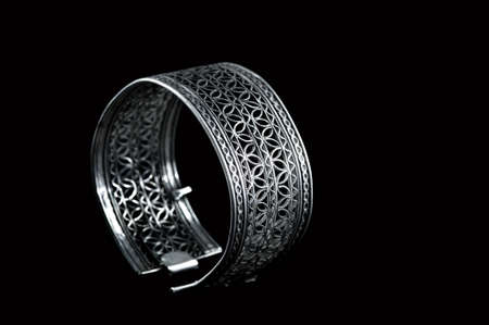 Vintage silver bracelet on black background 免版税图像