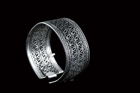 Vintage silver bracelet on black background 版權商用圖片