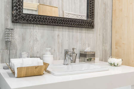 Close-up of a washbasin with a faucet in the bathroom