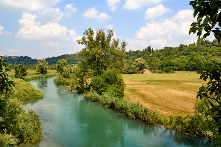 italian landscape: Rural Italian landscape with river in summer Stock Photo