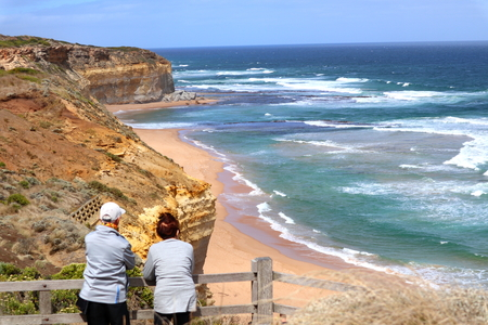 Two elderly couple looking out the beach by the Gibson Steps, Australia