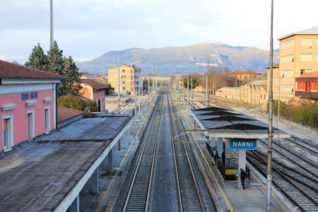 terni day: The medieval village of Narni seen from the train station and the industrial distracted in the valley, Umbria, Italy. Editorial
