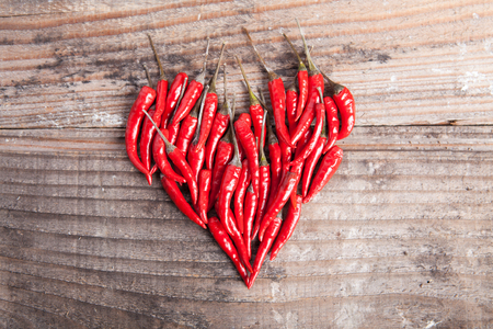red chili pepper: Heart made with red hot chili pepper Stock Photo
