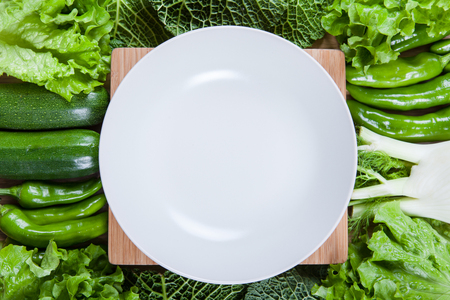 Directly above view of raw vegetables on wooden table photo